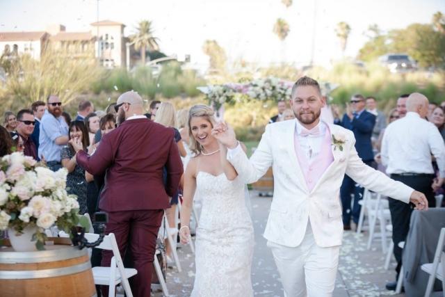 Newly married couple dances down aisle