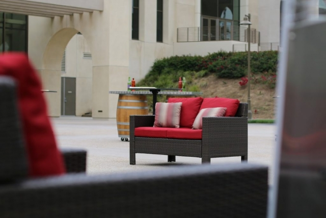 Outdoor lounge area with red cushions