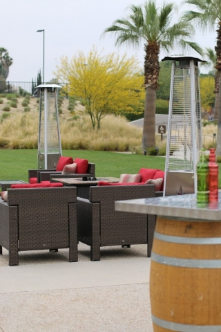 Outdoor lounge area with tall heaters