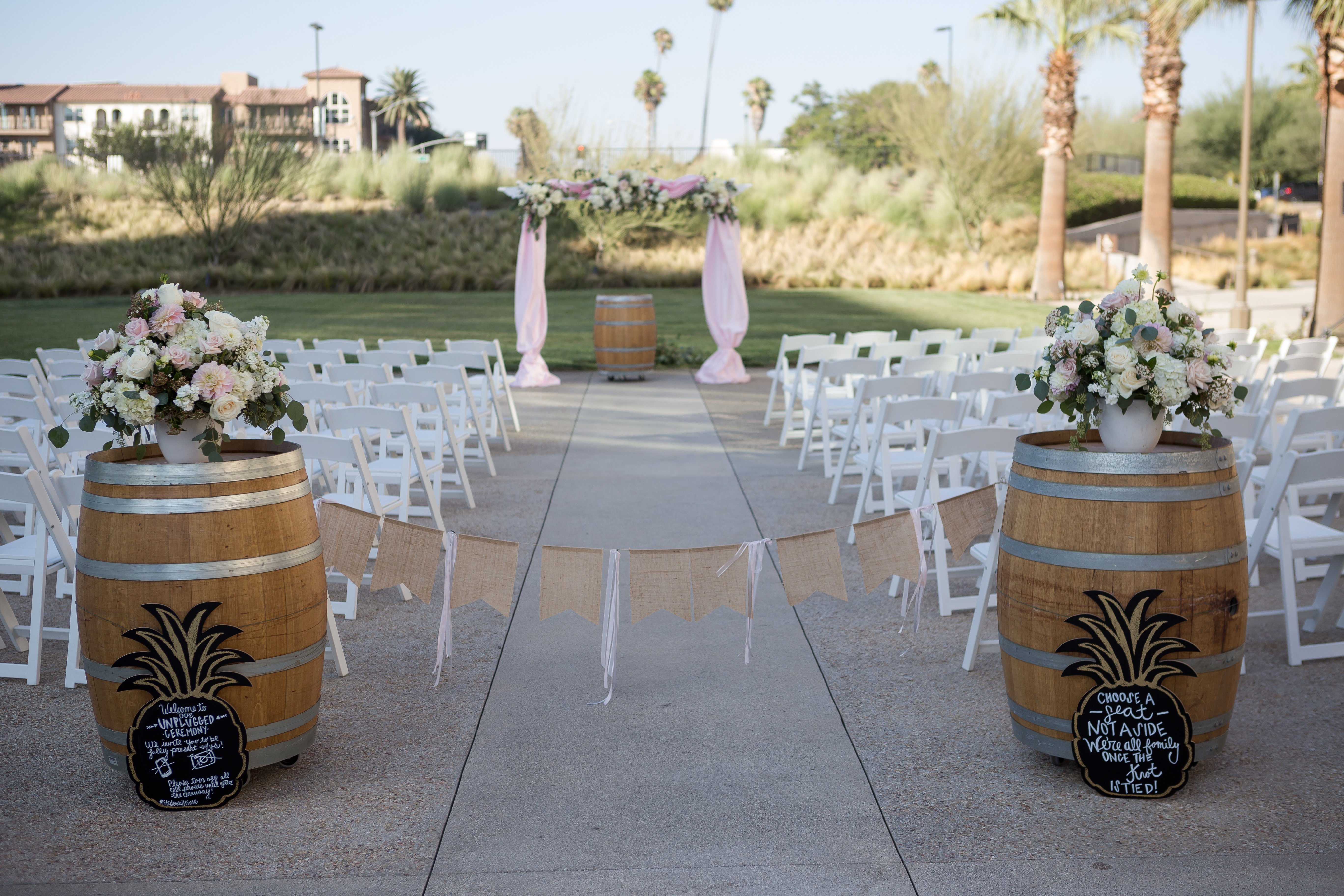 Two decorated barrels at seating for wedding