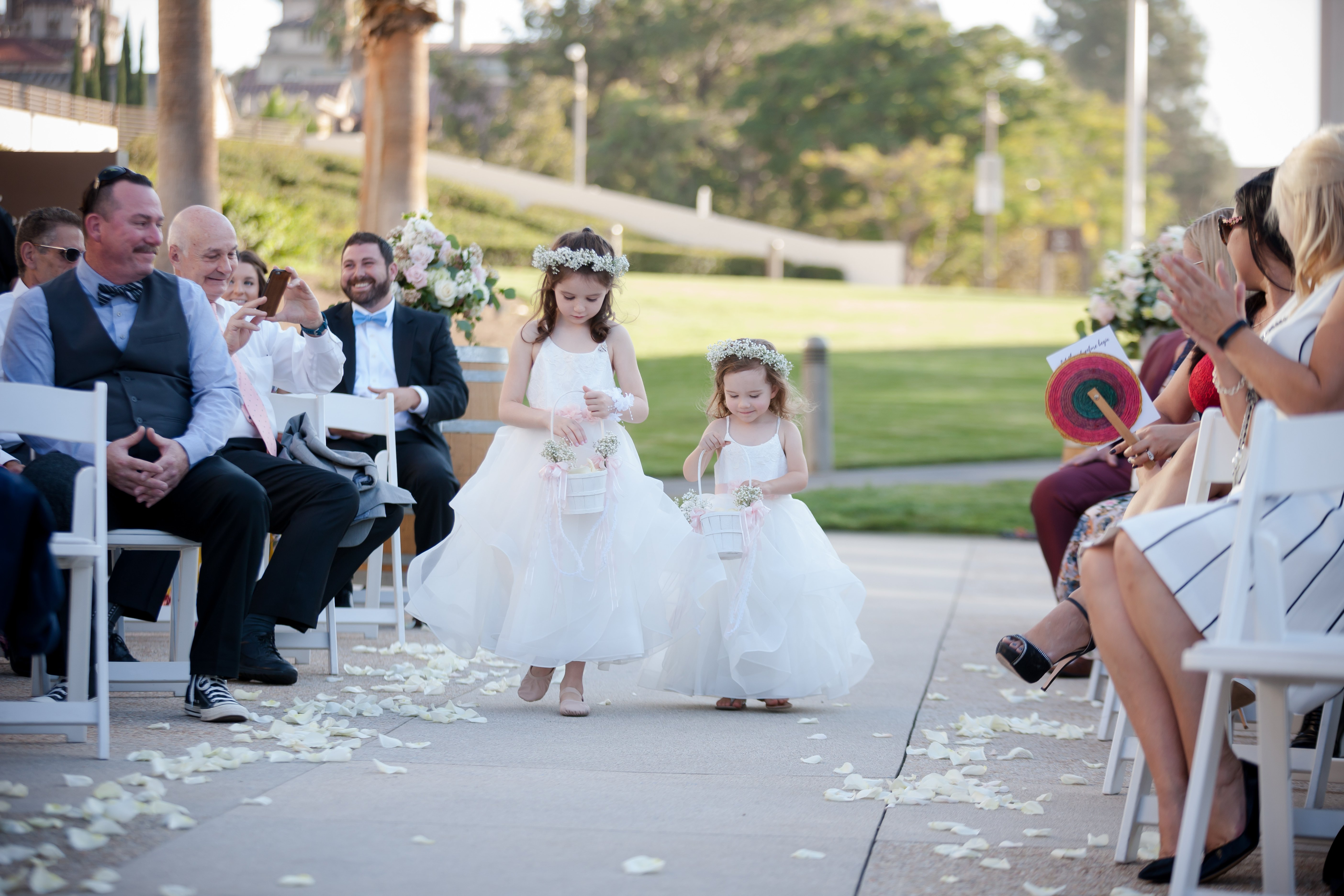 Two flower girls walking down the aisle