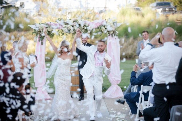 Bride and Groom dance down aisle after their vows