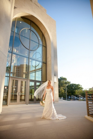 Bride poses outside the Riverside Convention Center