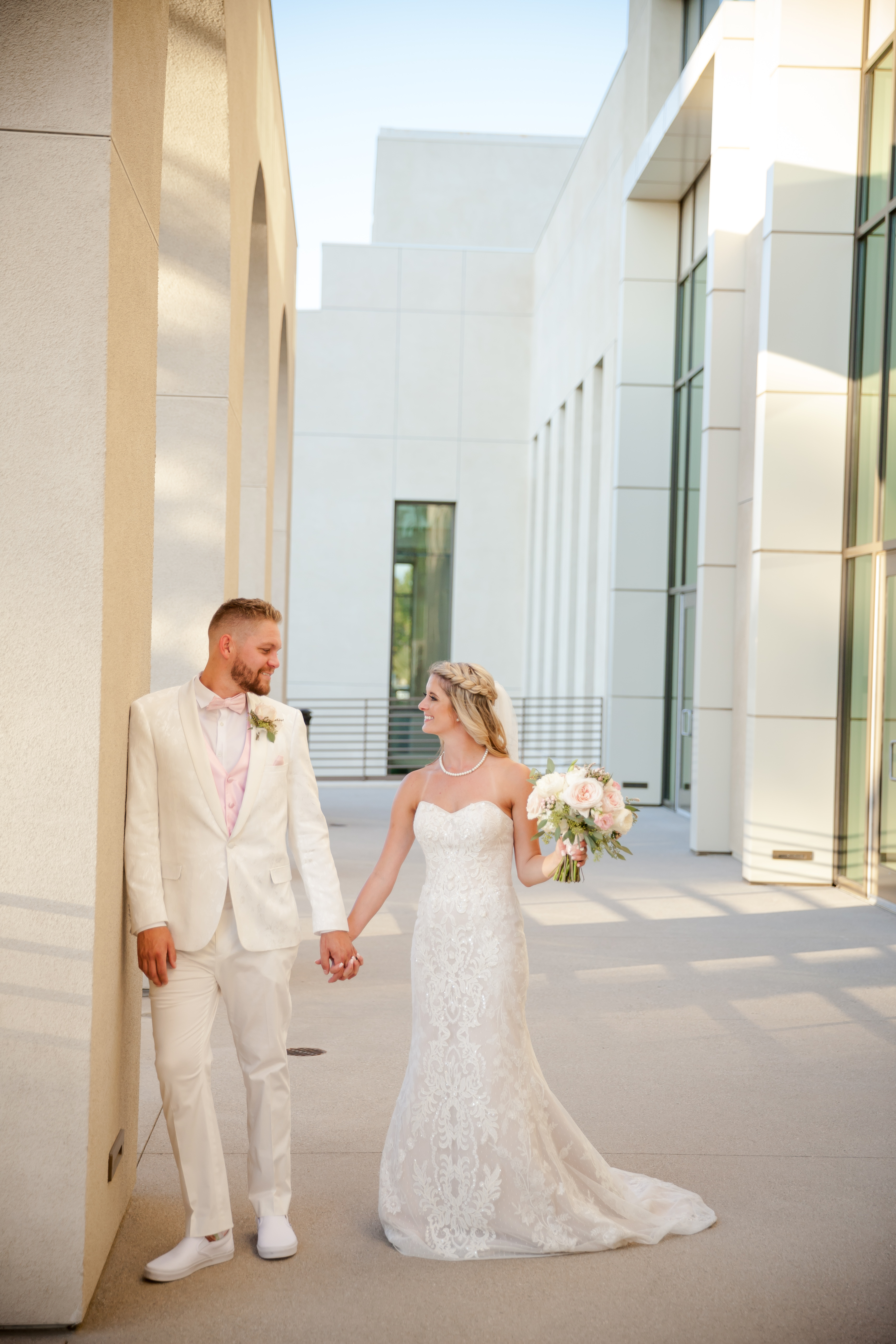 Bride and groom pose outside the Riverside Convention Center