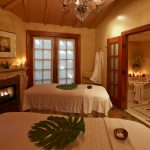 Mission Inn spa with massage tables and romantic bath.
