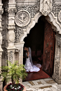 View of newly wedded couple through the Mission Inn chapel entrance.