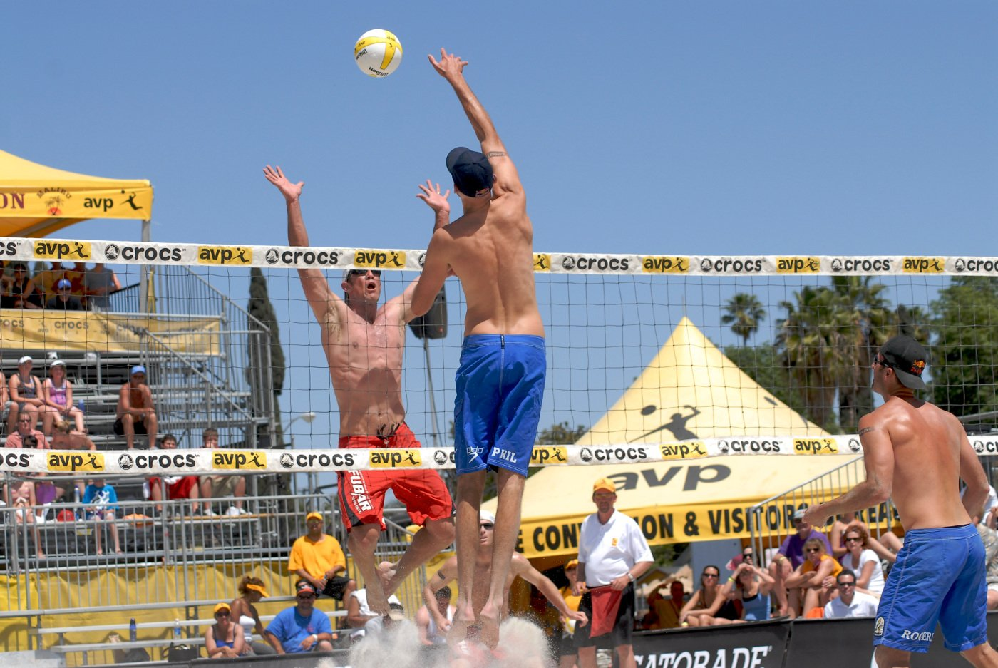 Men playing team volley ball