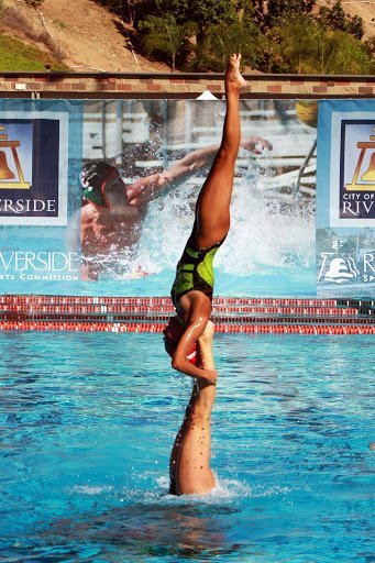 Synchronized swimmers at the Riverside Aquatics Complex