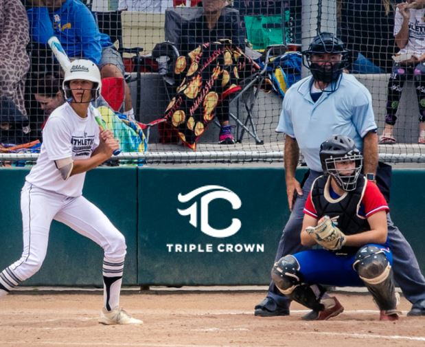 Triple Crown logo during a Baseball game showing a female batter ready for the pitch