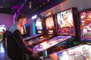Man plays pinball at the Game Lab