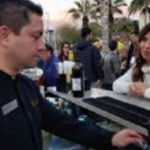 Bartender serves drinks to convention goers